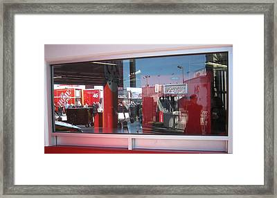 Window Reflections At The Speedway Framed Print
