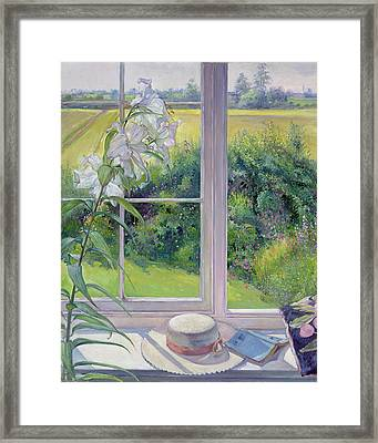 Window Seat And Lily Framed Print