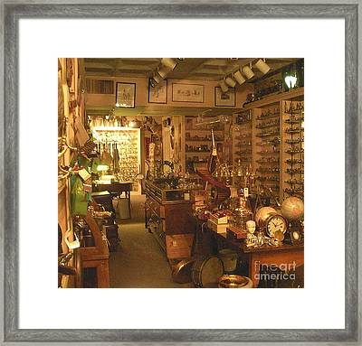 Window Shopping Framed Print by Joseph Baril