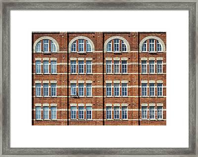 Windows And Bricks Framed Print