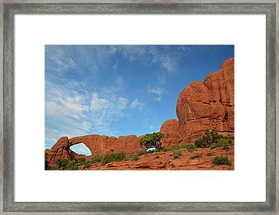 Framed Print featuring the photograph Windows Arches With Wispy Clouds by Bruce Gourley