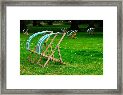 Windy Chairs Framed Print by Harry Spitz