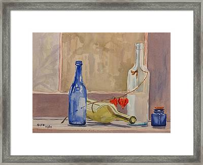 Wine Bottles On Shelf Framed Print by Debbie Homewood