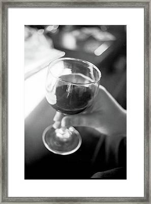 Wine In Hand Framed Print