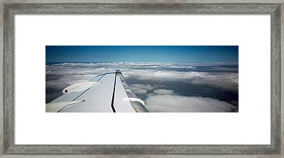 Wing Of An Airplane Framed Print by Panoramic Images