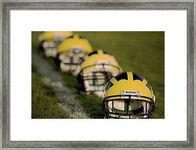 Winged Helmets On Yard Line Framed Print