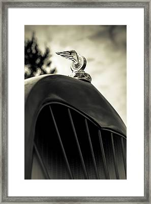 Winged Wheel Framed Print by Caitlyn Grasso