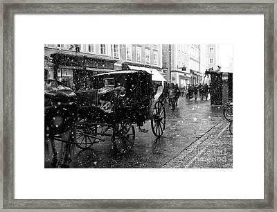 Winter Buggy In Salzburg Framed Print by John Rizzuto