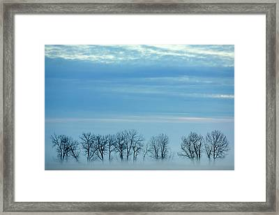 Winter Envelops Framed Print