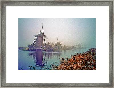Framed Print featuring the photograph Winter Morning Kinderdijk by Nigel Fletcher-Jones