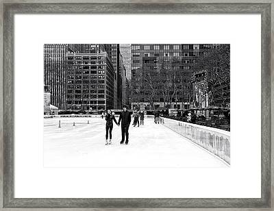 Winter Skating At Bryant Park Framed Print by John Rizzuto