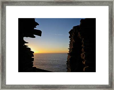 Winter Sunset At Tintagel Castle Cornwall Framed Print by Richard Brookes