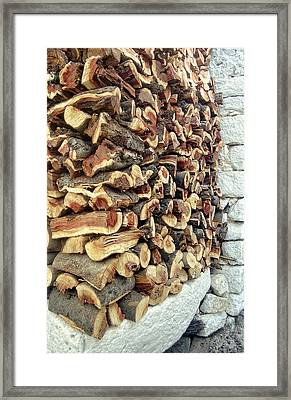 Winter Woodpile Framed Print