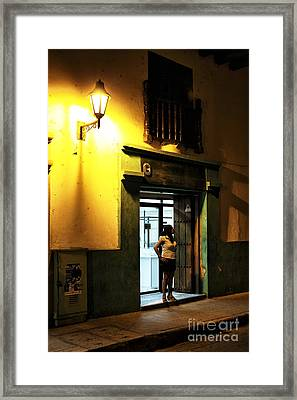 Wishing In Cartagena Framed Print by John Rizzuto