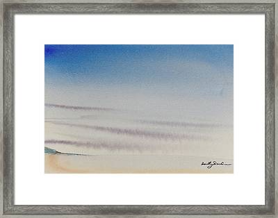 Wisps Of Clouds At Sunset Over A Calm Bay Framed Print