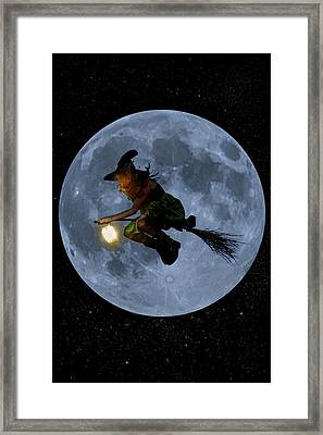 Witch Flying At Full Moon. Framed Print by Maggie McCall