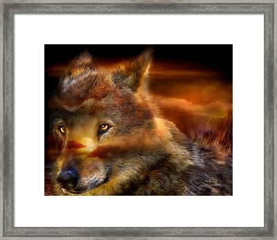 Wolfland Framed Print by Carol Cavalaris