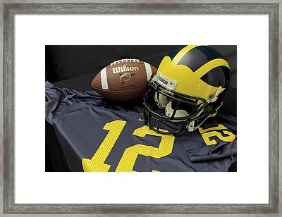 Wolverine Helmet With Football And Jersey Framed Print