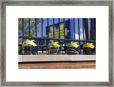 Wolverine Helmets Of Different Eras On Stadium Wall Framed Print