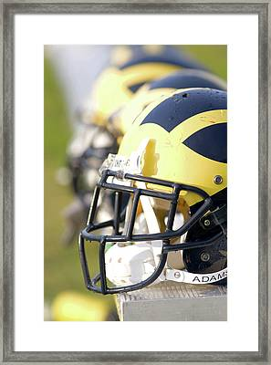 Wolverine Helmets On A Bench In The Morning Framed Print