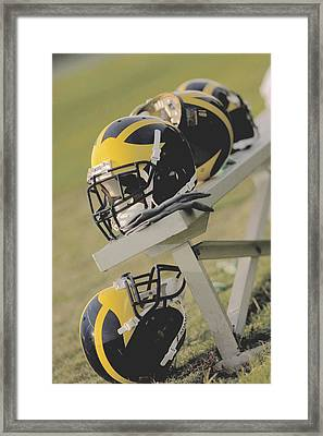 Wolverine Helmets On A Football Bench Framed Print