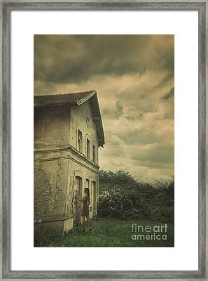 Woman And Abandoned House Framed Print