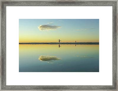 Woman And Cloud Reflected On Beach Lagoon At Sunset Framed Print