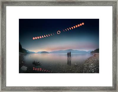 Woman And Girl Standing In Lake Watching Solar Eclipse Framed Print