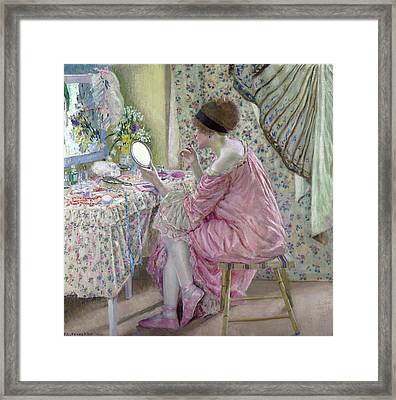 Woman Applying Makeup Framed Print by Frederick Carl Frieseke