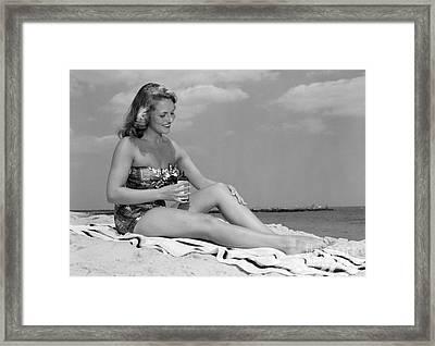 Woman Applying Suntan Lotion, C.1950s Framed Print