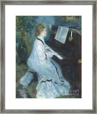 Woman At The Piano Framed Print by Pierre Auguste Renoir