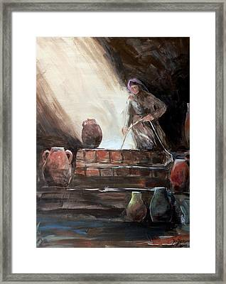 Woman At The Well  Framed Print by Jun Jamosmos