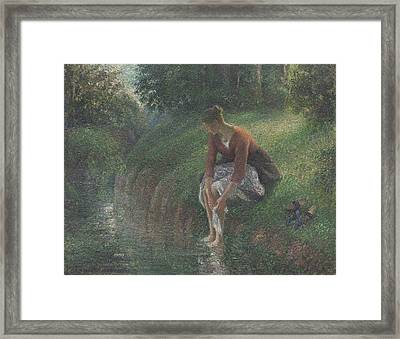 Woman Bathing Her Feet In A Brook Framed Print by Camille Pissarro
