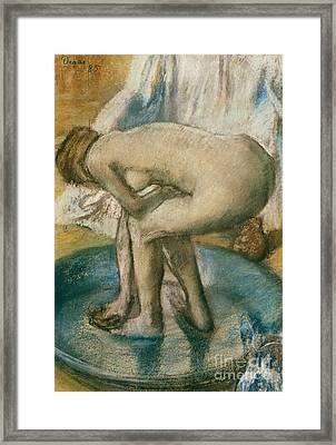 Woman Bathing In A Shallow Tub, 1885  Framed Print by Edgar Degas