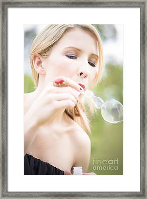 Woman Blowing Bubbles Framed Print by Jorgo Photography - Wall Art Gallery