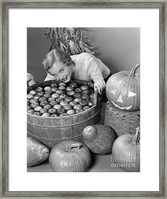 Woman Bobbing For Apples, C.1950s Framed Print by H. Armstrong Roberts/ClassicStock
