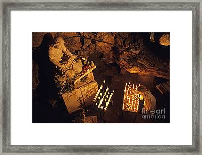 Woman Burning Candle At Troglodyte Sainte-marie Madeleine Holy Cave Framed Print by Sami Sarkis