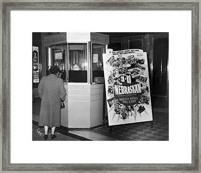 Woman Buying Movie Ticket Framed Print by Underwood Archives