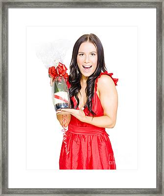 Woman Celebrating Success With Champagne Bottle Framed Print