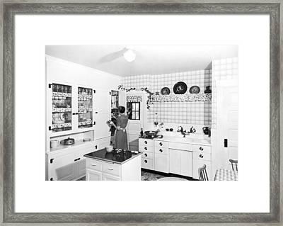 Woman Cooking In Her Kitchen Framed Print