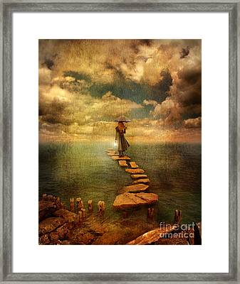 Woman Crossing The Sea On Stepping Stones Framed Print by Jill Battaglia