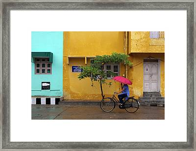 Woman Cycling In Street Framed Print