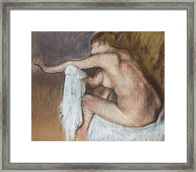 Woman Drying Her Arm Framed Print by Edgar Degas