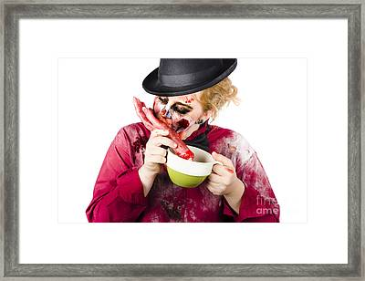 Woman Eating Bloody Hand Framed Print