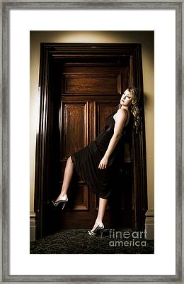 Woman Entering Hotel Door Framed Print