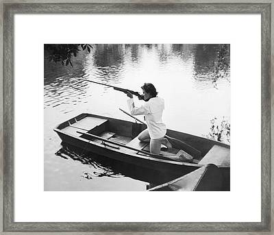 Woman Firing A Rifle Framed Print by Underwood Archives
