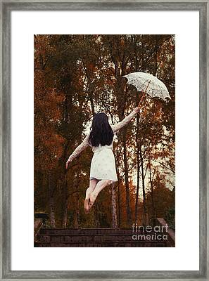 Woman Floating Away With Parasol Framed Print by Amanda Elwell