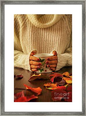 Woman Hands Holding Teacup And Autumnal Foliage Framed Print by Luigi Morbidelli