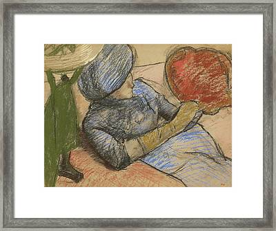 Woman Holding A Hat In Her Hand Framed Print