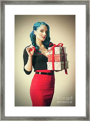 Woman Holding Christmas Presents Framed Print by Amanda Elwell
